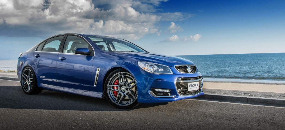 RO1 Matt Gunmetal rims on blue SSV Commodore Redline