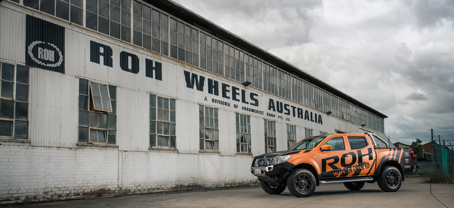 ROH NP300 Navara in front of ROH Warehouse with Assassin wheels