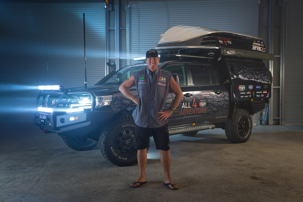 Jase from All 4 Adventure standing in front of LC200 with Octagon wheels