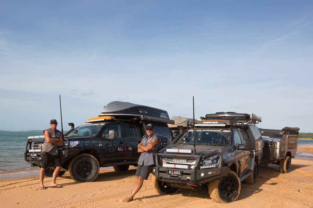 Jase and Simon from All 4 Adventure on beach in front of their vehicles