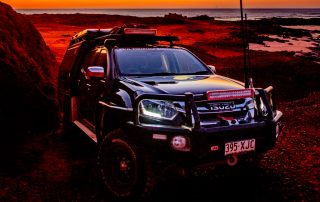 Steel 4x4 rims 4WD Touring Isuzu dusk background