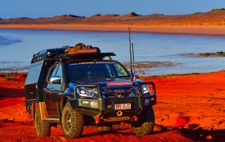 Sunraysia Steel 4WD Touring DMAX lake red dust background