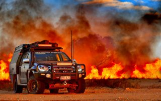 Steel wheels 4WD Touring DMAX bushfire background