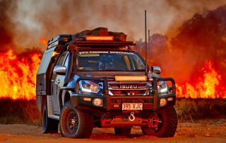 Black Steel wheels 4WD Touring Isuzu Fire smoke background