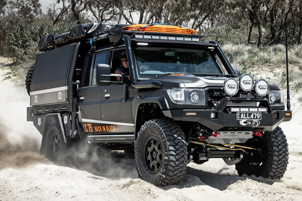 Black 4WD Wheels on Toyota Landcruiser 79 series on beach