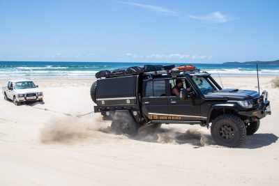 4x4 Wheels Toyota Landcruiser 79 series towing on the beach