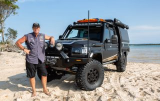 Jason in front of All479 with Black Octagon on Toyota LandCruiser 79 Series on the beach