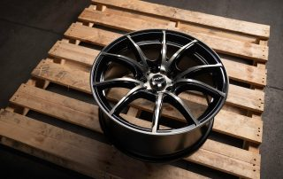Sprint R gloss black machined wheel on pallet in warehouse