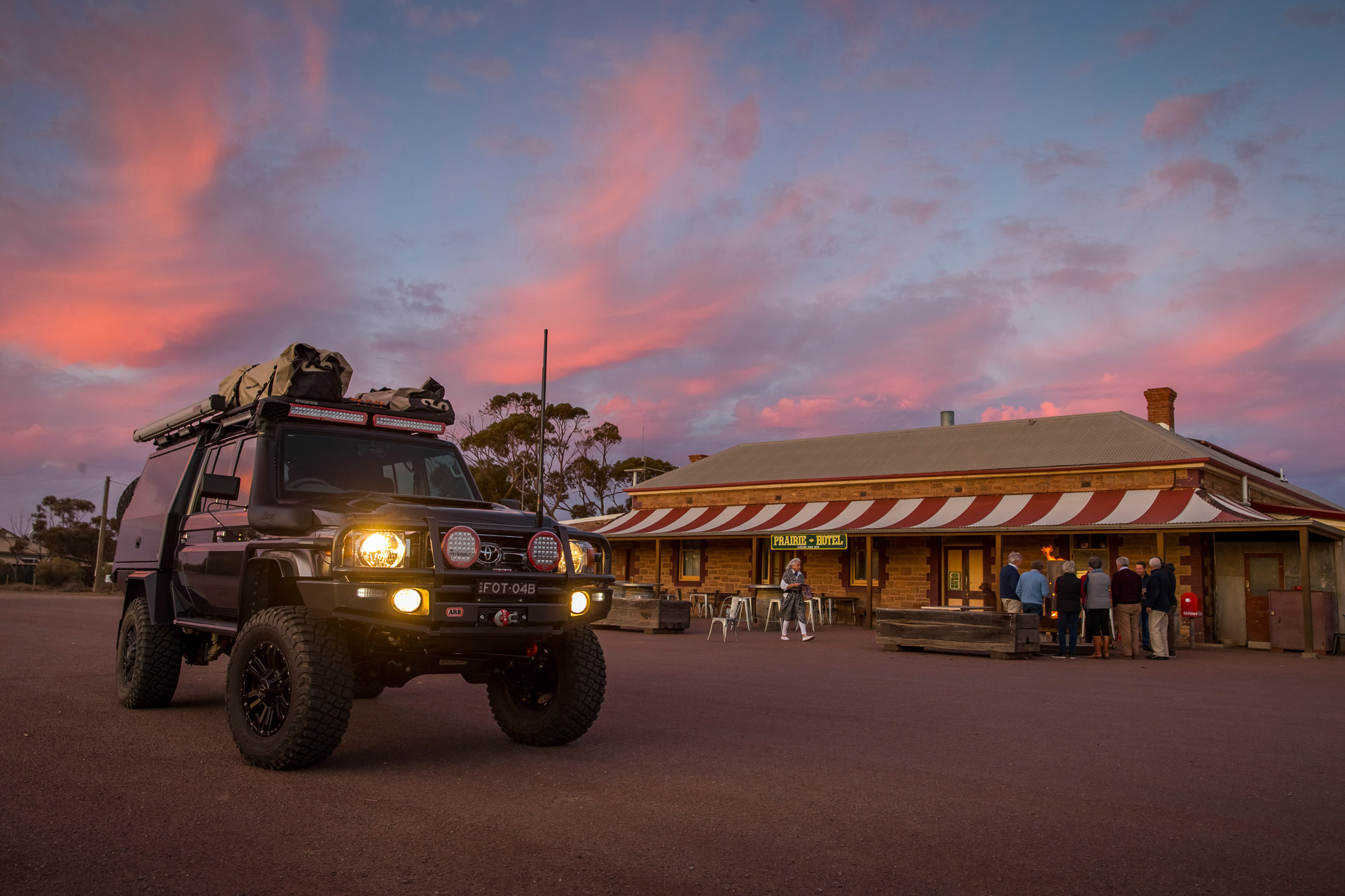 ROH Vapour wheels on 79 Series LandCruiser in front of local outback pub