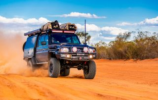 ROH Vapour wheels on 79 Series LandCruiser in desert stirring up dust