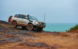 ROH 4WD Trophy wheel LC200 Cape York on rocks with ocean view