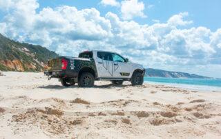Nissan 4x4 wheels on Whiteline Navara on beach with ocean view