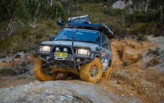 Muddy 4WD wheels on Offroad Adventure Show Jackaroo being winched