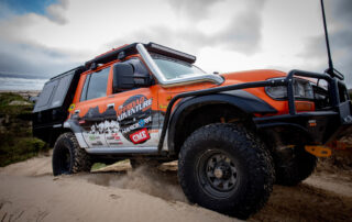 Toyota LandCruiser 4WD Steel wheels on Offroad Adventure Show driving through sand dunes