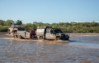 LandCruiser 79 series with Maverick 4x4 black wheels crossing river