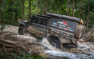 ROH Maverick 4x4 black wheels on 79 series Landcruiser going through river