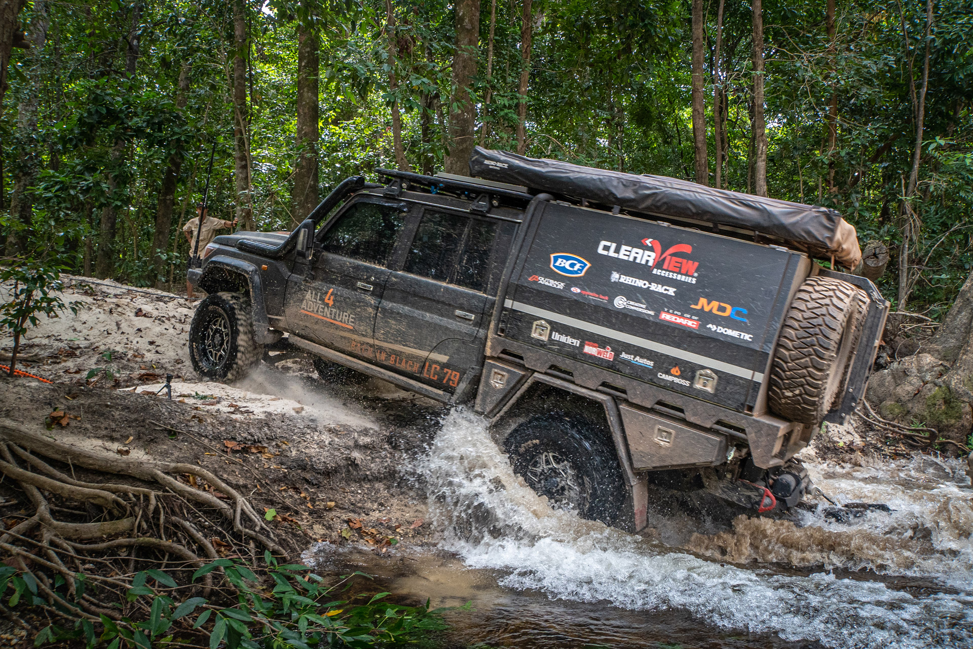 ROH Maverick 4x4 black wheels on 79 series Landcruiser going through river