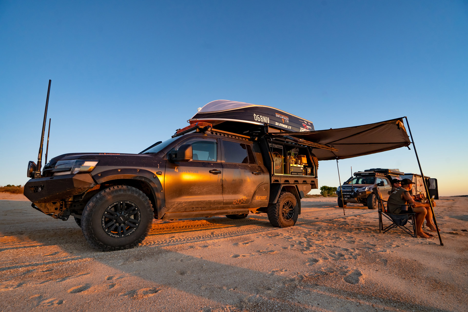 All 4 Adventure LandCruiser 200 Series with ROH Vapour wheels on the beach at sunset with Jase and Simon
