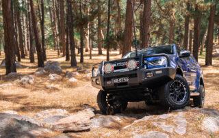 Havoc wheels Isuzu D-Max on rocks in forest