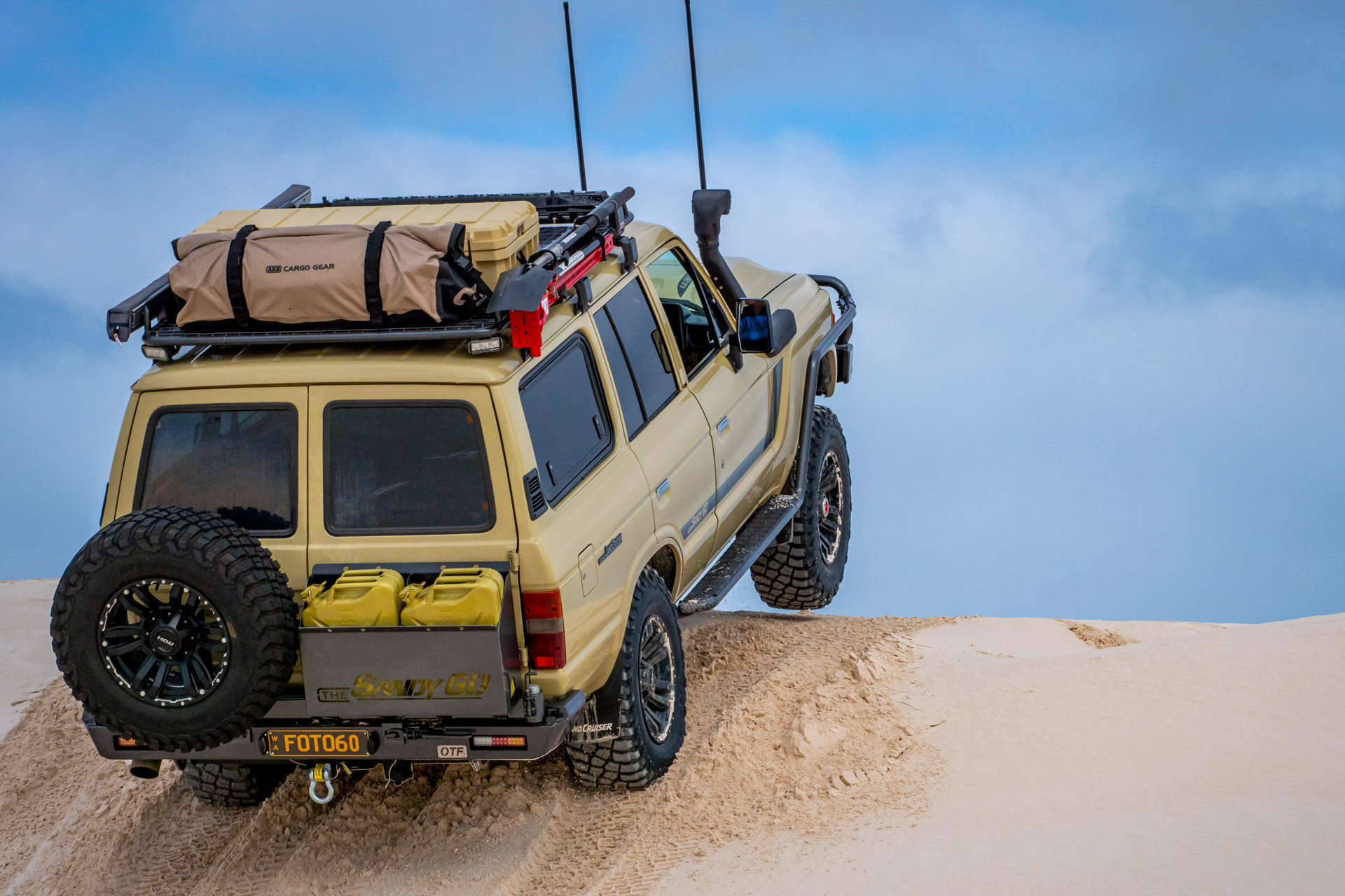 ROH Vapour wheels on Sandy 60 Series LandCruiser on the beach getting airborne