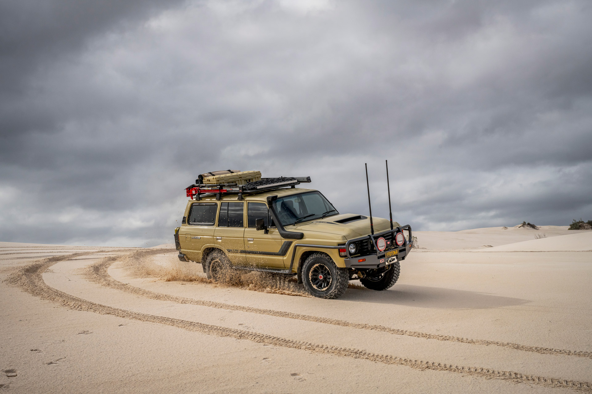 ROH Vapour wheels on Sandy 60 Series LandCruiser carving up the beach
