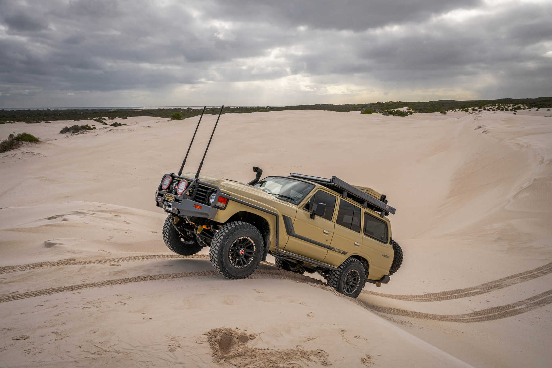 ROH Vapour wheels on Sandy 60 Series LandCruiser getting air on sand dunes